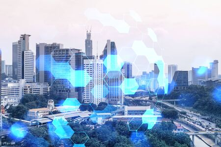 Abstract technology icons hologram over panorama city view of Kuala Lumpur, Malaysia, Asia. The concept of people networking and connections. Double exposure. Reklamní fotografie