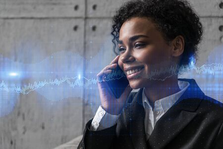Businesswoman speaks phone and stock market financial chart hologram. Double exposure. Online trading bonds, shares and currencies concept.