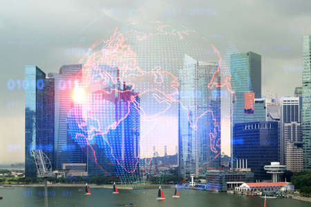 Glowing hologram of Earth planet map on aerial panoramic cityscape of Singapore at sunset, Asia. The concept of international business. Multi Exposure.