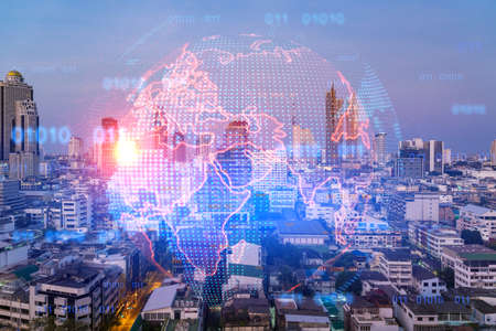 Multi exposure of Bangkok cityscape sunrise background and world map hologram. Concept of media networking.