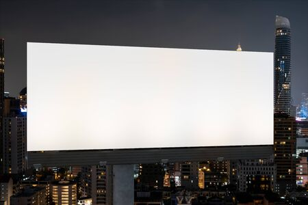 Blank white road billboard with Bangkok cityscape background at night time. Street advertising poster, mock up, 3D rendering. Front view. The concept of marketing communication to promote idea. Archivio Fotografico