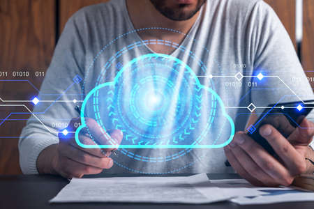 Double exposure of man signing contract with phone and cloud hologram drawings. Concept of big data center.