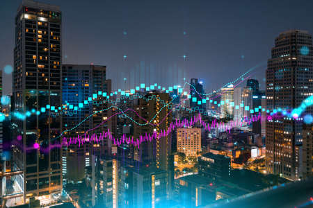 FOREX graph hologram, aerial night panoramic cityscape of Bangkok, the developed location for stock market researchers in Asia. The concept of fundamental analysis. Double exposure. Stock Photo