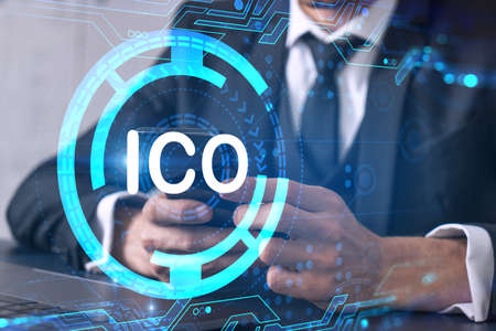 Businessman search and analyze using on-line app on phone. ICO icon hologram. Foto de archivo