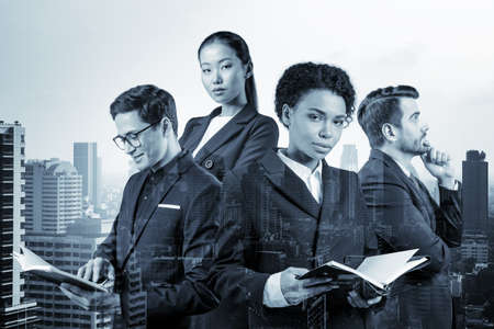 Group of four business colleagues in suits working on project together to gain new career opportunities. Concept of multinational corporate team in Bangkok. Double exposure. Banque d'images