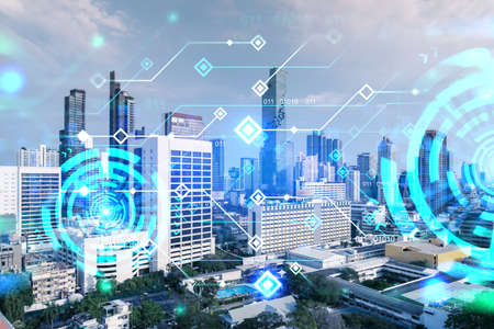 Technology hologram over panorama city view of Bangkok. The largest tech hub in Asia. The concept of developing coding and high-tech science. Double exposure. Stockfoto