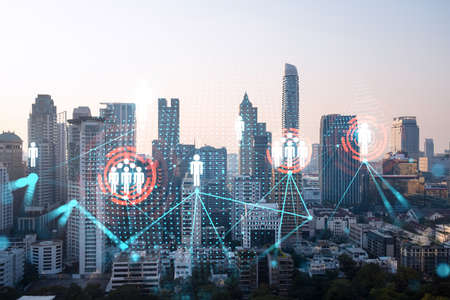 Hologram of social media icons over sunset panoramic cityscape of Bangkok, Asia. The concept of people connections. Multi exposure.