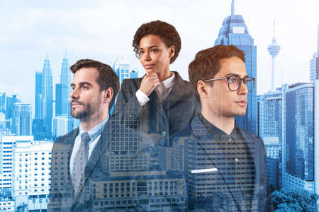 Group of three business colleagues in suits working and dreaming about new career opportunities after MBA. Concept of inspiration and multinational corporate team. Kuala Lumpur. Double exposure.