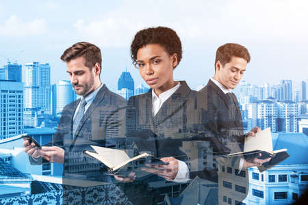 Group of three business colleagues in suits working on project together to gain new career opportunities. Concept of multinational corporate team. Kuala Lumpur. Double exposure. 版權商用圖片