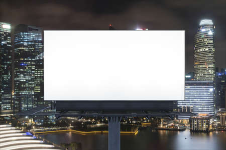 Blank white road billboard with Singapore cityscape background at night time. Street advertising poster, mock up, 3D rendering. Front view. The concept of marketing communication to sell idea.