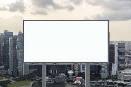 Blank white road billboard with Singapore cityscape background at sunset. Street advertising poster, mock up, 3D rendering. Front view. The concept of marketing communication to sell idea. Zdjęcie Seryjne