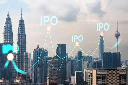 IPO icon hologram over panorama city view of Kuala Lumpur. KL is the hub of initial public offering in Malaysia, Asia. The concept of exceeding business opportunities. Double exposure.