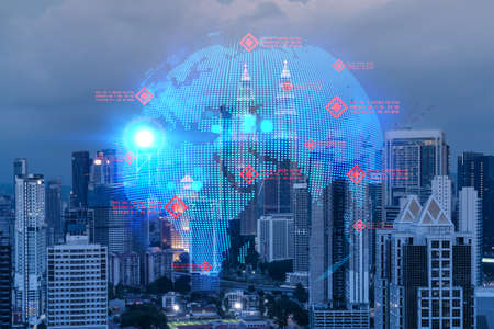 Hologram of Earth planet map on night panoramic cityscape of Kuala Lumpur, Malaysia, Asia. The concept of international companies in KL. Multi Exposure.