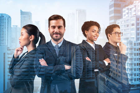 Front view of four successful smiling business consultants standing in a row in suits and ready to tackle with customer problem. Bangkok cityscape. Multinational corporate team. Double exposure.
