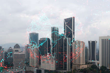 World planet Earth map hologram over panorama city view of Kuala Lumpur, Malaysia, Asia. The concept of international connections and business. Multi Exposure. Stock Photo
