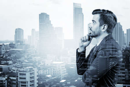 Young handsome businessman in suit with hand on chin thinking how to succeed, new career opportunities, MBA. Bangkok on background. Double exposure.