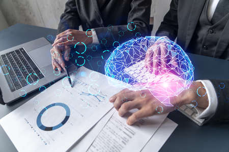 Two business people working together on IT project. Brainstorm concept. brain hologram. Double exposure.