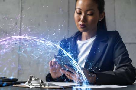 Businesswoman using phone, work in modern office on new project. Double exposure. Concept of success. Abstract technology hologram.