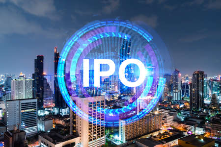 Initial public offering hologram, night panoramic city view of Bangkok. The financial center for multinational corporations in Asia. The concept of boosting the growth by IPO process. Double exposure.