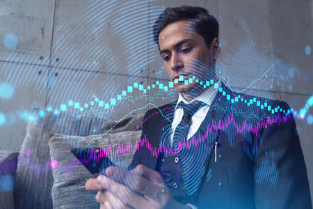 Trader in office working with Smartphone, FOREX graph hologram to analyze market behavior, typing phone. Double exposure. Zdjęcie Seryjne