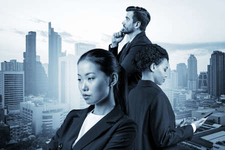 Group of three business colleagues in suits dreaming about new career opportunities after MBA graduation. Concept of multinational corporate team. Bangkok on background. Double exposure. Banque d'images