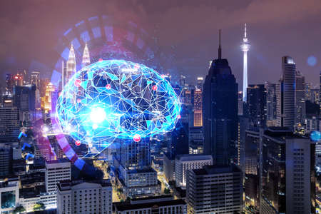 Human brain hologram, aerial panoramic city view of Kuala Lumpur at night. KL is the educational cluster in Malaysia, Asia. The concept of artificial intelligence. Double exposure. Banque d'images