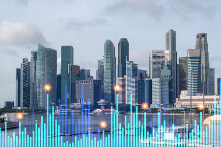 Financial stock chart hologram over panorama city view of Singapore, business center in Asia. The concept of international transactions. Double exposure. Reklamní fotografie