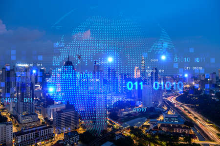 Hologram of Earth planet map on night panoramic cityscape of Kuala Lumpur, Malaysia, Asia. The concept of international companies in KL. Multi Exposure. Reklamní fotografie