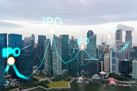 IPO icon hologram over panorama city view of city, the hub of initial public offering in Asia. The concept of exceeding business opportunities. Double exposure.