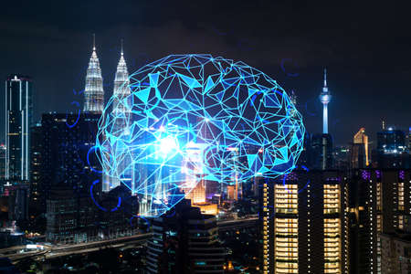 Human brain hologram, aerial panoramic city view of Kuala Lumpur at night. KL is the educational cluster in Malaysia, Asia. The concept of artificial intelligence. Double exposure. Reklamní fotografie