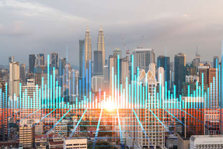 Glowing FOREX graph hologram, aerial panoramic cityscape of Kuala Lumpur at sunset. Stock and bond trading in KL, Malaysia, Asia. The concept of fund management. Double exposure.