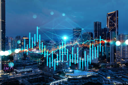 FOREX graph hologram, aerial night panoramic cityscape of Kuala Lumpur. KL is the developed location for stock market researchers in Malaysia, Asia. The concept of fundamental analysis.