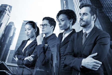 Four successful business consultants standing in a row in suits and ready to tackle with customer problem.