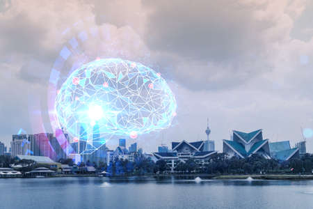 Brain hologram over panorama city view of Kuala Lumpur. KL is the largest science hub in Malaysia, Asia. The concept of developing coding and high-tech science. Double exposure. 免版税图像