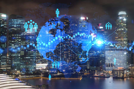 Glowing Social media icons on night panoramic city view of Singapore, Asia. The concept of networking and establishing new connections between people and businesses. Double exposure. 免版税图像
