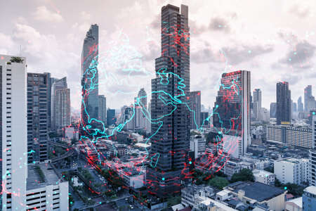 World planet Earth map hologram over panorama city view of Bangkok, Asia. The concept of international connections and business. Multi Exposure.