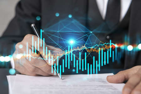 Double exposure of man sign a brokerage contract and financial chart. Success concept. Formal wear.