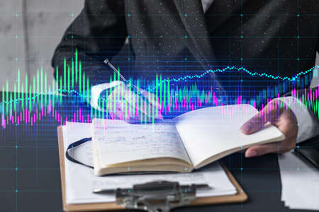 Multiexposure of woman taking notes and financial chart. Success concept. Formal wear. Standard-Bild