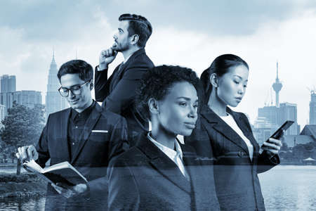 Group of four business colleagues in suits working and dreaming about new career opportunities after MBA graduation. Concept of multinational corporate team. Kuala Lumpur. Double exposure.