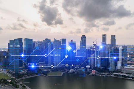Glowing hologram of technological process, aerial panoramic cityscape of Singapore at sunset. The largest innovative hub of tech services in Asia. Multi exposure.