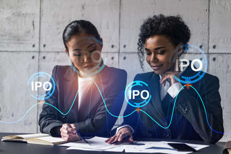 Two businesswomen work together in modern office on new project. Double exposure. Concept of success. IPO symbol icon.
