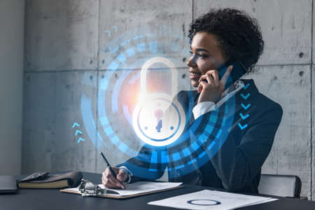 Businesswoman speaks phone and lock hologram. Double exposure. Security information protection concept.