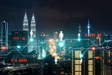 Glowing Social media icons on night panoramic city view of Kuala Lumpur, Malaysia, Asia. The concept of networking and connections between people and businesses in KL. Double exposure. Reklamní fotografie