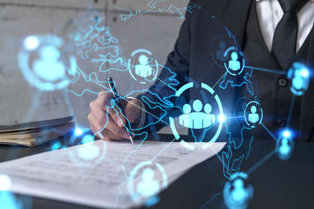 Businessman in suit signs contract. Double exposure with social media and planet hologram. Man signing agreement on research. People network concept.