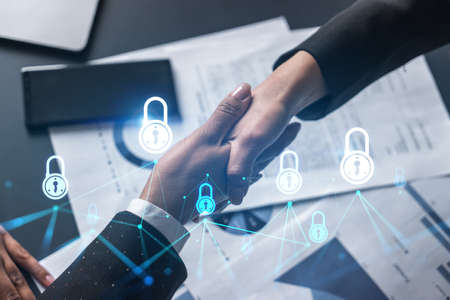 Multiexposure of two businesspeople handshake and lock icon hologram drawing background. Concept of internet business security information data. Formal wear.
