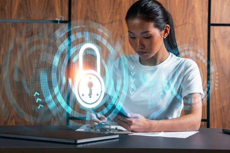 Woman takes notes with phone. Security and data protection concept hologram. Multiexposure.