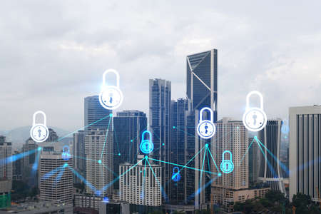 Padlock icon hologram over panorama city view of Kuala Lumpur to protect business, Malaysia, Asia. The concept of information security shields. Double exposure.