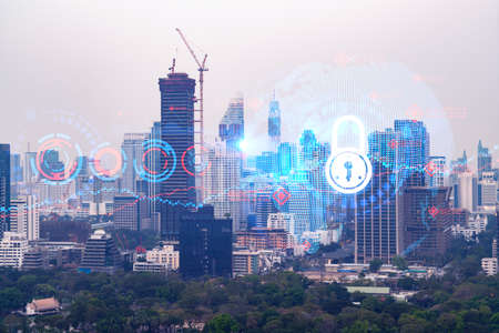 Padlock icon hologram over panorama city view of Bangkok to protect business in Asia. The concept of information security shields. Double exposure.