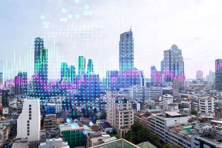 Financial stock chart hologram over panorama city view of Bangkok, business center in Asia. The concept of international transactions. Double exposure.
