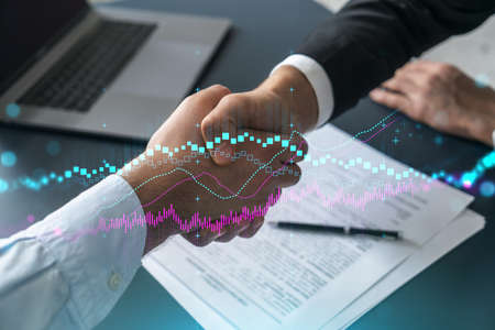 Multiexposure of two businesspeople handshake and forex graph hologram drawing background. Concept of financial market. Formal wear. Фото со стока